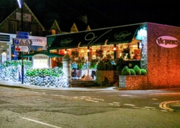 Victoria's Restaurant in Pitlochry shown at night with the outdoor area all lit up